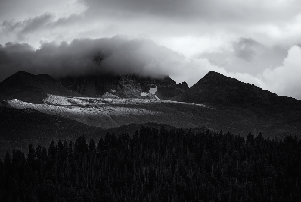 Longs Peak in Cloud. Last light of the day and an August snow dusting. Colorado, 2014