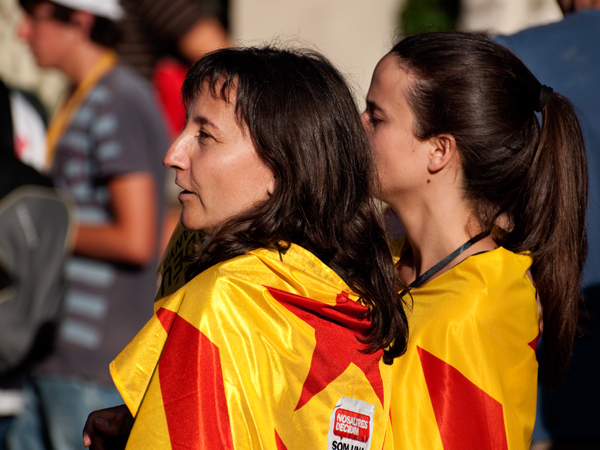 Two Women Wrapped in Flags. Barcelona, 2010